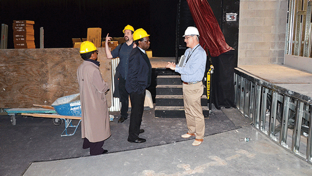 From left to right:  Vice President of Advancement and Community Affairs Lorita Williams, Sound Technician Oliver Seagle, Director of Fine and Performing Arts Marshall Hughes, and Vice President of Administration and Finance Kevin Hepner take a tour of the Media Arts Center, mid-renovation.