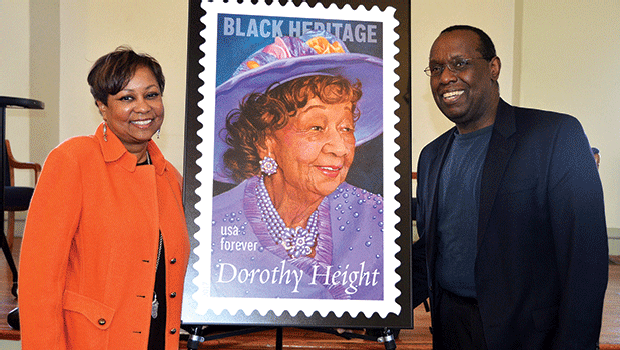 Dr. Valerie Roberson and Marshall Hughes, director of RCC's Media Arts Center, pose with the commemorative Dorothy Height stamp, which was unveiled at the First Church of Roxbury on February 27.