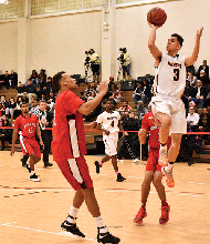 Freshman guard Imer Ortiz finesses his way past Bunker Hill's defense.