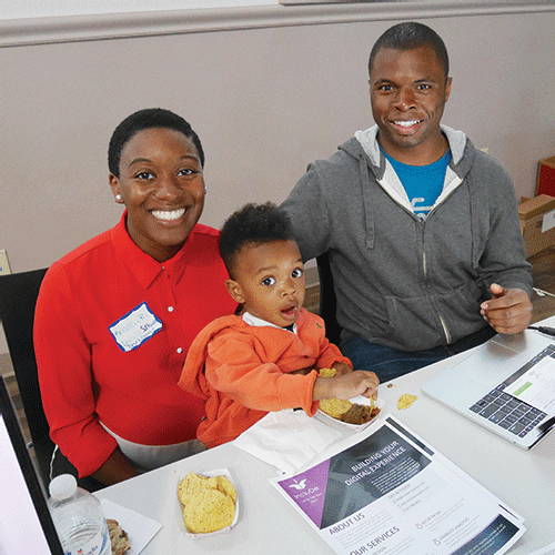Mass Innovation Nights exhibitor Kristen Ransom, founder and CEO of IncluDe software development and digital design agency, had some extra support at her table from 2-year-old son Pierce and husband Brandon Ransom.