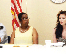 Dave Williams (left), president of the Southbridge Public Schools Association, and Aveann Bridgemohan, a Mattahunt parent,  looked on as Trinity Kelly, an Excel student, spoke on the experience of being in a turnaround school. The three were panel member durings a State House briefing last week.