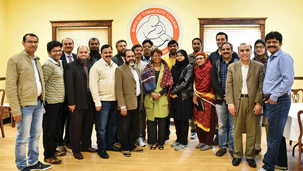 A group of administrators from technical colleges in Pakistan pose with Dr. Roberson. Each semester, administrators from Pakistan visit RCC to learn more about the community college system in the US.