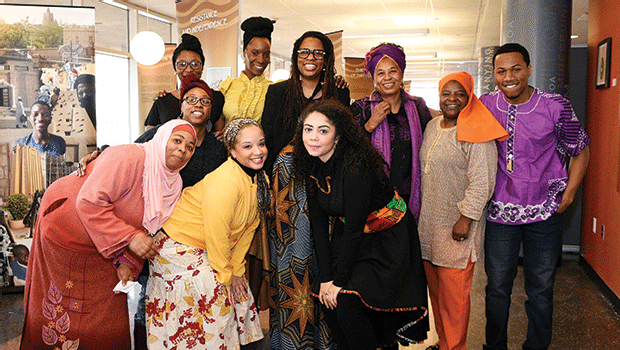 Members of RCC's Muslim Student Association pose with Okolo Rashid, co-founder of the International Museum of Muslim Cultures, after her lecture on the Legacy of Timbuktu Exhibit.