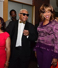 Larry Dodson of The Bar-Kays and his family stroll the red carpet.