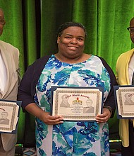 The New Tri-State Defender Publisher Bernal E. Smith II (right) accepted the 2017 Emory O. Jackson Best Column Writing first-place award on behalf of Lee Eric Smith, the newspaper's deputy editor, during the 2017 NNPA Merit Awards at the National Harbor in Prince George's County Md., on June 22. Also pictured (left to right): Askia Muhammad, third place for The Washington Informer; and Kenya Vaughn accepting for Mike Jones, who won second place for the St. Louis American. (Photo: Mark Mahoney/NNPA)