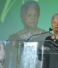 Newly-elected NNPA Chairman Dorothy R. Leavell gives remarks during the 2017 NNPA Legacy Awards Gala as outgoing chair, Washington Informer publisher Denise Rolark Barnes, looks on. (Roy Lewis/NNPA)