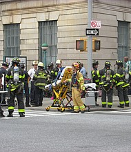 FDNY firefighters respond to t the train derailment on 125th Street