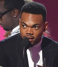 Chance the Rapper accepts the award for best new artist at the BET Awards Sunday in Los Angeles.
