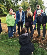 Participants in an urban foraging workshop discover some of the healthy, edible foods all around us.