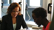 Anika Tourse portrays attorney Sara Garcia, here consulting with Ahmed (Barkhad Abdi).