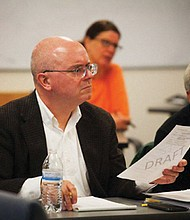 Paul Anthony (left) during a meeting of the Portland School Board.