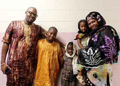 The Jondot family of Midlothian joins the celebration at the Arthur Ashe Jr. Athletic Center. Henry Jondot and his wife, Fanta Jondot, are with their children, from left, Charles, 11, Emma, 7, and Jenna, 2.