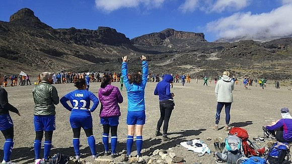 They came, they saw, they conquered -- and broke a world record. Having climbed up Africa's highest mountain, taking goal ...