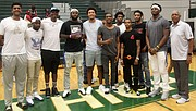 The Tigers-Vols alumni game provided an opportunity for U of M head coach Tubby Smith's next edition of the Tigers to get a feel for the history and legacy of the Tigers and stars such as Penny Hardaway (third from the left).