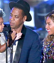 Blue Ivy Carter with her parents Jay-Z and Beyoncé