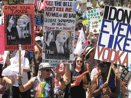 Despite blistering heat, hundreds of Trump opponents gathered Sunday to march the streets of Downtown Los Angeles.