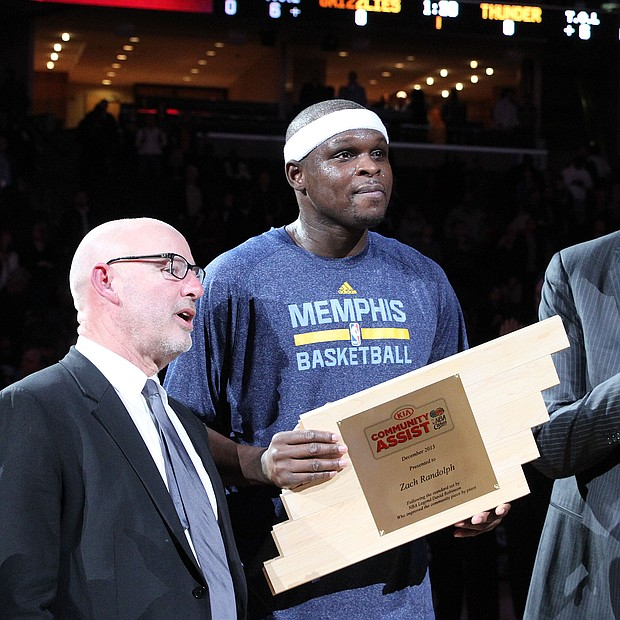Z-Bo receives the Kia Community Assist award for the month of December 2013.