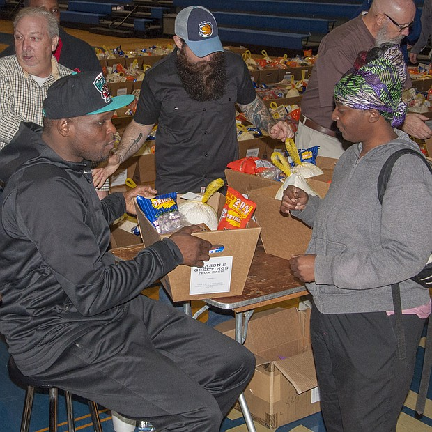 Randolph hands off the assist to a fan at Hamilton High School. Z-Bo routinely donated holiday meals to families in need. (Photo: Shirley Jackson)