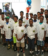 Telecommunications company AT&T hosted the historic West Baltimore James Mosher Little League U-11 Team at the Harbor East AT&T store in downtown Baltimore on Friday, June 30, 2017. As part of AT&T's commitment to sponsoring the team in the Ripken Baseball Blue Crab Tournament this summer, the players were treated to a night at Orioles Park and received pristine new uniform jerseys they will wear during the six day tournament scheduled to begin on Sunday, July 9, 2017 in Aberdeen. Founded in 1960, James Mosher Baseball, an