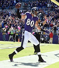 Baltimore Ravens tight end Crockett Gillmore spikes the ball after scoring a touchdown against the Washington Redskins in 2016.