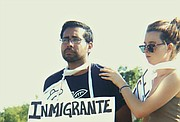 A demonstrator protests the treatment of immigrants
