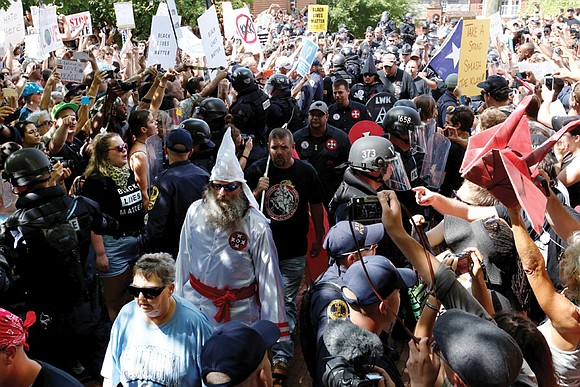 More than 1,000 people turned out to shout down a group of Ku Klux Klan members last Saturday at a ...