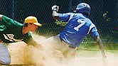 William Gary, right, of the Richmond Blue Sox slides safely into third base despite Duncan McGrath of Riverside covering him during last Sunday's final in the RBI Tournament in Richmond.