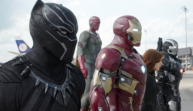 This image released by Disney shows, from left, Chadwick Boseman as Panther, Paul Bettany as Vision, Robert Downey Jr. as Iron Man, Scarlett Johansson as Natasha Romanoff, and Don Cheadle as War Machine in a scene from Marvel's Captain America: Civil War.