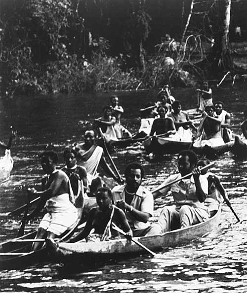 S. Allen Counter (in canoe in foreground) on a trip through the Suriname rainforest with the descendants of escaped African slaves.