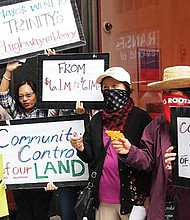 Lydia Lowe (second from right), director of the Chinatown Community Land Trust, and others protested Trinity Financial's high asking sales price on an affordable housing complex. Should tenants be able to acquire the property, they intend to put it into the land trust.