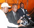 SCLC President Rev. Dr. Charles Steele Jr. (center) addresses media Tuesday near the 1968 Sanitation Strike exhibit at the National Civil Rights Museum. He was joined by Rev. Dr. Dwight Montgomery (left) and Rev. Walter Womack, president and vice president of the Memphis SCLC chapter.