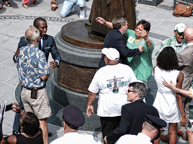 5. City officials, Walker family members, statue sculptor, arts commission members, National Park Service staff and others embrace after the historic unveiling.