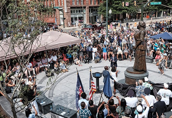 Richmond residents and officials rejoiced Saturday morning as the long-awaited statue of hometown hero Maggie Lena Walker was unveiled.