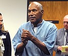 O.J. Simpson (C) reacts after learning he was granted parole at Lovelock Correctional Center, in Lovelock, Nevada, USA, 20 July 2017. Simpson is serving a nine to 33 year prison term for a 2007 armed robbery and kidnapping conviction. (EPA/Jason Bean / Reno Gazette-Journal - via The Undefeated)