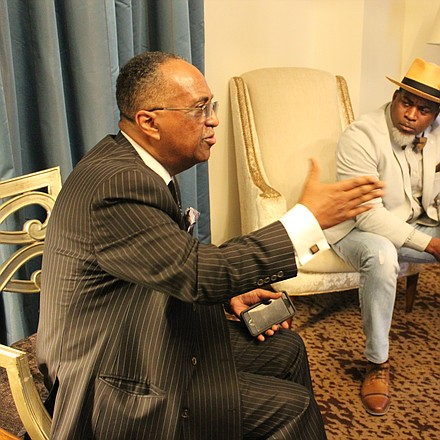 SCLC President Dr. Charles Steele Jr. talks with rapper/activist David Banner before Banner's lecture at the Peabody Hotel.