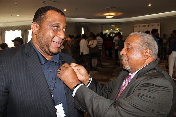 In a moving moment, Dr. Bernard Lafayette, who was with Dr. Martin Luther King hours before he was gunned down in Memphis, gave his own SCLC lapel pin to Rev. Gregory Bentley of the Huntsville Alabama chapter of SCLC.