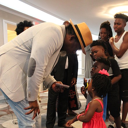 David Banner interacts with a young fan after his presentation at SCLC's National Convention.