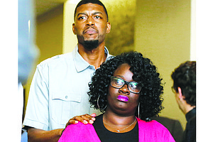 Jordan Edwards' parents Odell and Charmaine Edwards arrive at a news conference. A White former Texas police officer has been indicted on a murder charge in the shooting death of their 15-year-old son, July 17.