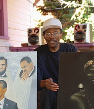 Henry Frison poses at his Portland home with two of his favorite works, 'Under the Spotlight,' depicting President Obama and other civil rights icons, and 'African Prince' a painting Frison describes as his masterpiece.