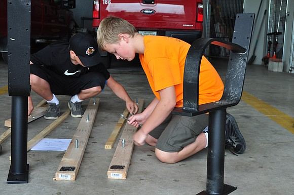 A team of volunteers led by a New Lenox Boy Scout spent the weekend installing 10 new benches along the ...