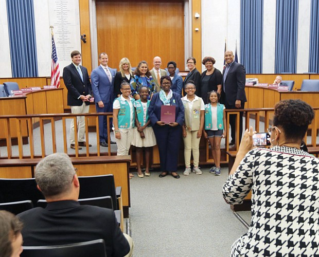 Honoring historic Girl Scout troops Scout leader Glennys Fleming, center, holds the resolution honoring Girl Scout Troops #34 and #35 that was presented Monday night by Richmond City Council to Ms. Fleming and several scouts from the troops sponsored by Ebenezer Baptist Church. Historic Troop #34, the first African-American troop in the South, was chartered in March 1932 after Emma Watson wanted her daughter to participate in scouting as she had before moving to Richmond from Chicago. With the support of influential Richmond women such as Maggie L. Walker and Lena Watson, dean of students at Virginia Union University, Ms. Watson advocated for the local Girl Scouts council to create a local African-American troop. It met at VUU. In 1936, Troop #35 was established at Ebenezer Baptist Church, which began sponsoring Troop #34 in 2015.