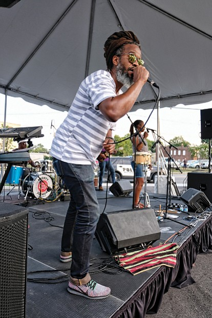 Church Hill jam // Mighty Joshua and the Zion #5, left, get the crowd moving at Jammin' in July last Friday at the Bon Secours Sarah Garland Jones Center, 2600 Nine Mile Road, in Church Hill.