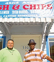 Cedric Burton (left) and Aaron Peterson welcome customers to their new restaurant, 42nd Avenue Fish and Chips, which recently opened at 5302 N.E. 42nd Ave.