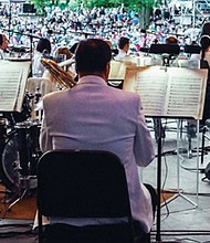 The Oregon Symphony performs an outdoor concert. The symphony's just completed season set records for number of concerts, attendance, revenue and ticket sales.