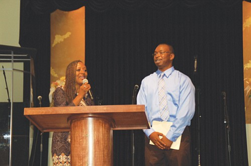 Pastor April Murchinson of Emmanuel Temple Church introduces Good in the Hood President Shawn Penney during a special ceremony at the north Portland church on Sunday to honor him for his bravery and leadership in response to the death threats made against the multicultural celebration last June.