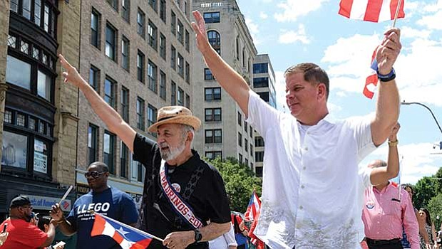 Suffolk County Register of Probate Felix D. Arroyo and Mayor Martin Walsh march in the parade.