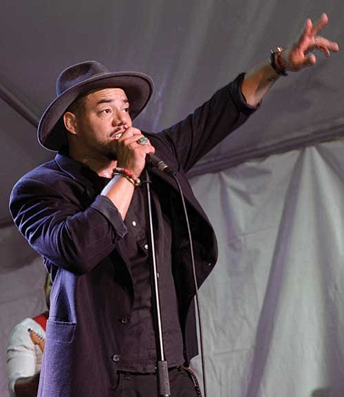 Popular French retro singer Ben l'Oncle Soul performs for the crowd.