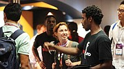 Edwin Jack, company CEO, and Kris Carter, concept artist, exhibit their game at a convention.