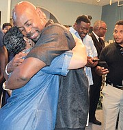 At a recent event where he detailed his MEMPOWER initiative, Ricky Wilkins embraces a loved one, much the same as he's embracing life as he battles a rare brain cancer.  (Courtesy photo)