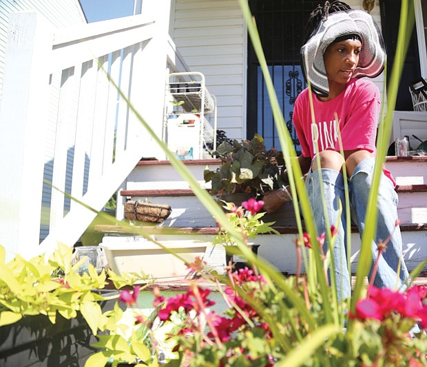 Cityscape // Gardening is a popular summer pastime in Richmond. Here, Monica Burton prepares to add new flowers to the plantings at her home in the 1900 block of Bainbridge Street in the Paradise Place neighborhood in South Side.